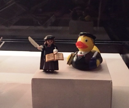 A playmobil Luther figure and a Luther rubber duck